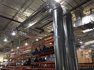 Precision-engineered ductwork conveys laundry, waste, recycling great distances in automated removal systems.